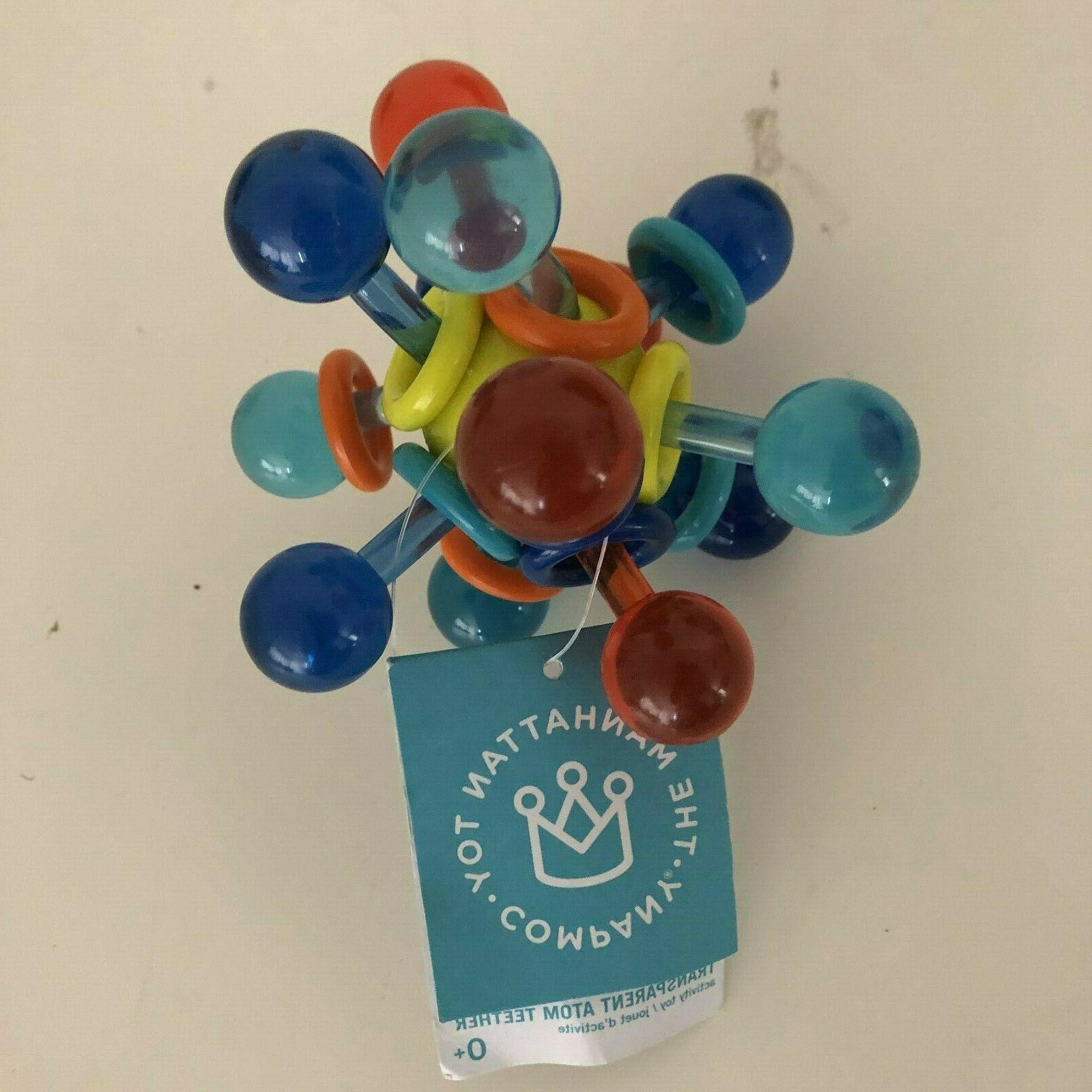 transparent atom rattle and teether grasping activity